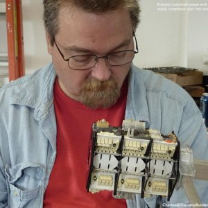 Model maker Richard Lindstrom poses with the Open Hex Module as it nears completion.