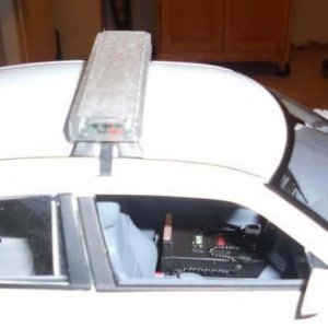 Canyon Co Charger  Detailed inside view of console, radios, mics, switch boxes, cable type seat belts. Resin Casted Items