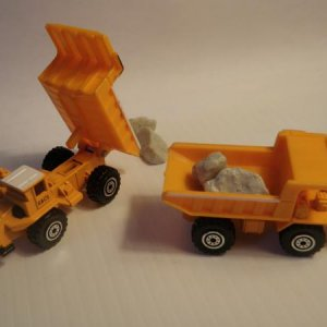 unidentified dump trucks