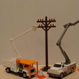 Matchbox GMC Topkick bucket trucks in similar paint schemes