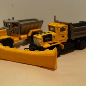 Gray/yellow Oshkosh snow plows