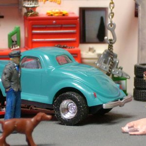 Turquoise Dash '36 Coupe Spare-Tirectomy, Goop filled.