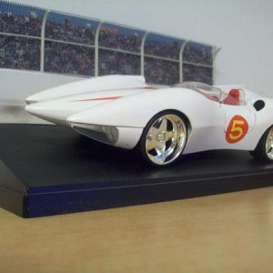 Mach 5 1/24 from the movie. The base I bought on clearance and has a cover.