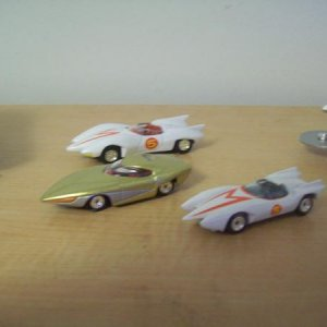 1/64 of the Mach 5 and the GRX from Johnny Lightning. The closest Mach 5 was in the Volume 4 disc of Speed Racer.